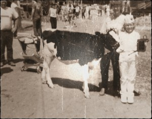 Laura at 11 years old with her first show calf Frisky